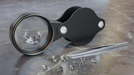 Diamonds with magnifying glass and a pair of tweezers